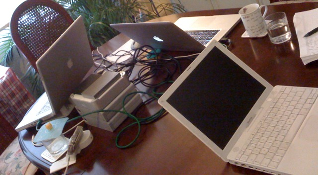 Image of laptops and hard-drives in temporary office space during an emergency